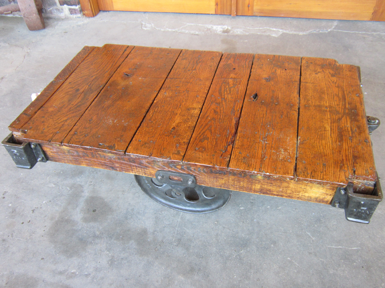 Dark, Pronounced Wood Grain And The Color Of The Red Oak Complement The  Polished Cast Iron Hardware On This Classic Lineberry Cart Coffee Table.